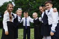 Young boys and girls in uniform outdoors stock image