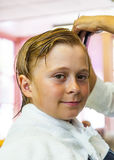 Young boys at the hairdresser. Attractive young boys at the hairdresser stock images