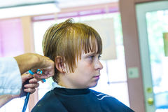 Young boys at the hairdresser. Cute young boys at the hairdresser stock photos