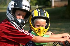 Young boys in helmets. Two young boys out riding wearing their helmets Stock Photos