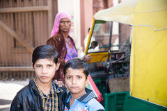 Young boys, Jodhpur, India. Jodhpur, India - 2015, January 4 : Two young Indian kids posing outside for the camera with a selfconfident look in Jodhpur Royalty Free Stock Photos