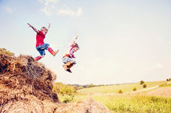 Young boys jump in the hay Royalty Free Stock Photography