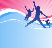 Young boys jumping against an abstract background. Stock Photos