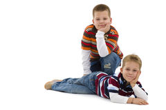 Young boys lying on floor Stock Images