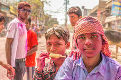 Young boys with a painted faces celebrating Holi festival in Ind Stock Image