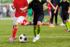 Young boys play soccer football match. Stock Photo