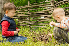 Young boys playing with matches Royalty Free Stock Photo