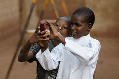 Young boys playing with a mobile phone Stock Photography