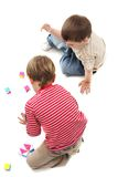 Young boys playing over white, top view Stock Photos