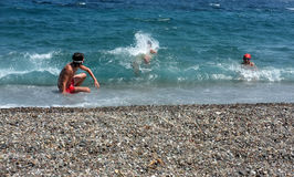Young boys  playing in the sea Stock Photography