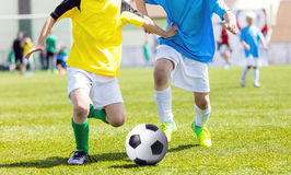 Young boys playing soccer match. Youth football tournament for young boys Stock Photography