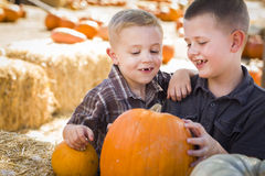 Young Boys at the Pumpkin Patch Talking and Having Fun Royalty Free Stock Images