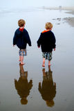 Twin boys with reflections on beach Royalty Free Stock Photography