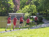 Young boys run in park Stock Image