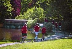 Young boys run in park Stock Photo