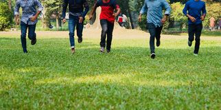 Young boys running around a park. Some of the young boys running in a group around a park unique photo stock photography