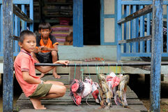 Young boys selling fresh fishes in Indonesia Royalty Free Stock Photography