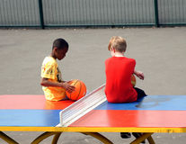 Young boys sit on a table tennis table Stock Images