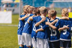 Young Boys of Sports Soccer Club Team Standing Together United. Kids Listening Coach Pre Match Speech. Motivated Junior Youth Soccer Players. Outdoor Sports royalty free stock images