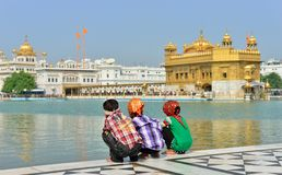 Young Boys Squatting in Golden Temple, Amritsar Royalty Free Stock Images