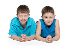 Young boys together on the white background Stock Image