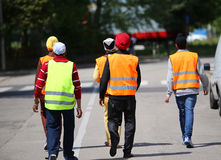 Young boys with turbans and the high visibility jackets walking. Through the streets duration of the surveillance patrols in the city Stock Photo