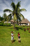 Young boys walking around Navala village, Viti Levu, Fiji Royalty Free Stock Photography