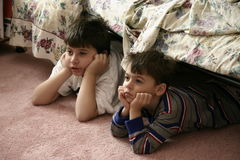 Young boys watching TV. Young boys totally engrossed in watching TV Royalty Free Stock Photography