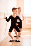 Young boys working at the barre royalty free stock image