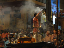 Young Brahmin priests conduct aarti. VARANASI, INDIA - NOV 5 -  Young Brahmin priests conduct aarti evening service on ghats of the Ganges,   on Nov 5, 2009, in Royalty Free Stock Images