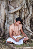 Young brahmin reads scripture Royalty Free Stock Photography