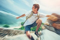 Young brave man hanging above the ocean royalty free stock photography