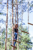 Young brave woman climbing in adventure rope park Royalty Free Stock Photos