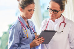 Young brazilian doctor and nurse with tablet Royalty Free Stock Photo