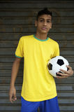 Young Brazilian Football Player Holding Soccer Ball Royalty Free Stock Image