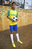 Young Brazilian Football Player Holds Soccer Ball Stock Image