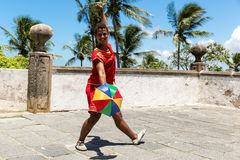 Young Brazilian man dancing Frevo in Olinda, Brazil Stock Photography