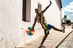 Young Brazilian man dancing Frevo in Olinda, Brazil Stock Photo