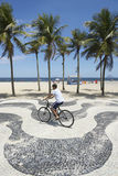 Young Brazilian Riding Bicycle Copacabana Rio Stock Photography