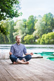 Young breaded man with closed eyes relaxing and meditaing in summer morning Royalty Free Stock Photo