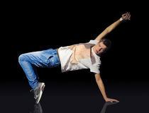 Young breakdancer on the floor Stock Photos