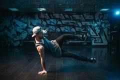 Young breakdance performer dancing in studio. Modern urban dance style. Male dancer Stock Photo