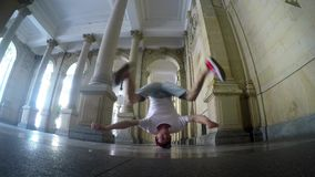Young breakdancer dancing on the street in Karlovy vary. stock footage