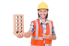 Young bricklayer with brick isolated on white Royalty Free Stock Photo