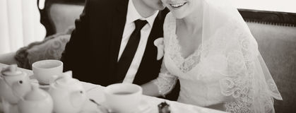 Young bridal couple sitting together Royalty Free Stock Image