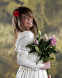 Young Bride. Beautiful young bride smiling and holding a bouquet of Star Gazer Lillies Stock Image