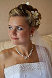 Young bride. Portrait, modern hairstyle with fresh white orchids Stock Image