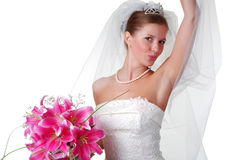 Young bride. With bouquet of lilys on a white background Stock Image