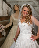 Young bride and antique mannequin Royalty Free Stock Photography
