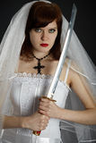 Young Bride armed sword Stock Photo
